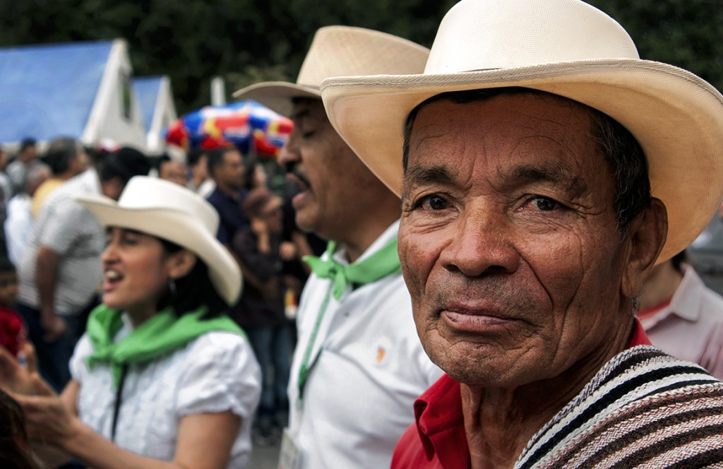 A farmer wanders through Libano, Colombia's main plaza during the Dia del Campesino (Day of the Farmer) celebration.