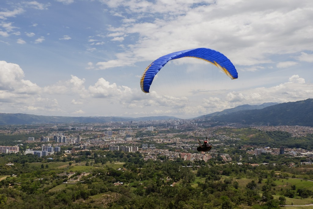 A paraglider takes flight at Ruitoque, just outside Bucaramanga, Colombia.